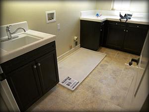 dual washing machine pan installed