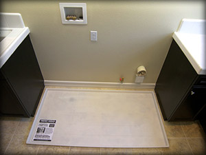 Coloring also allows dual washer and dryer pan to blend in with surrounding