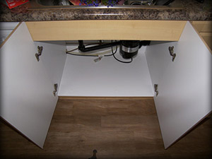 Cabinet without Slide N' Fit protector pan vulnerable to damage