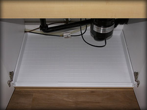Close-up view of DRIPTITE Slide N' Fit Under Sink Pan